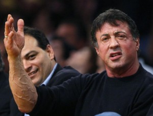 Actor Sylvester Stallone sits courtside as he watches NBA Western Conference final basketball playoff series in Los Angeles